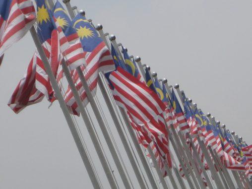 A row of Malaysian national flags outside Muzium Negara, Kuala Lumpur.